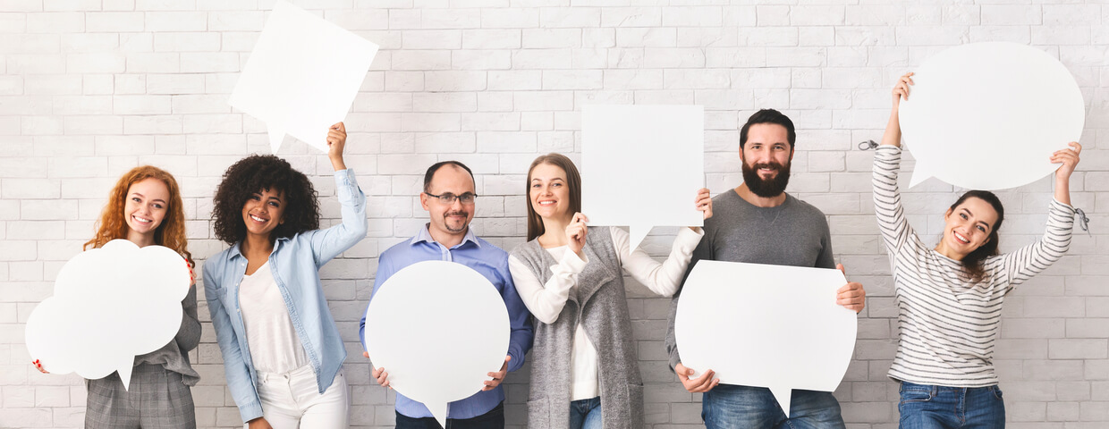Group of men and women standing side by side holding different speech bubbles